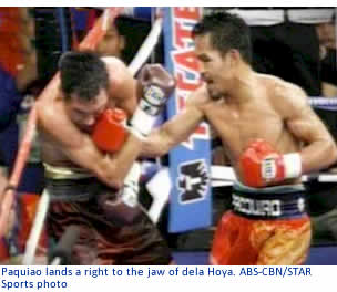 Paquiao lands a right to the jaw of dela Hoya.