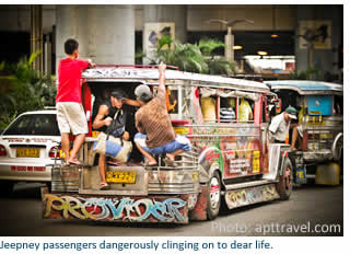 Jeepney passengers dangerously cling on to dear life.