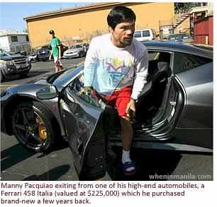 Manny Pacquiao exiting from one of his high-end automobiles, a Ferrari 458 Italia (valued at $225,000) which he purchased brand-new a few years back